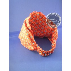 Halterjurkje voor meisje van 3 jaar met hoofddoekje